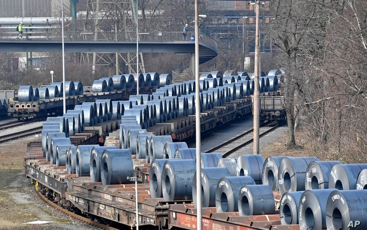 FILE - Steel coils sit on wagons when leaving the thyssenkrupp steel factory in Duisburg, Germany, March 2, 2018. President Donald Trump risks sparking a trade war with his steep tariffs on steel and aluminum imports, German officials and industry gr