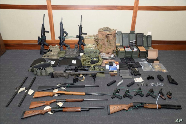 This image provided by the U.S. District Court in Maryland shows a photo of firearms and ammunition that was in the motion for detention pending trial in the case against Christopher Paul Hasson. Prosecutors say that Hasson, a Coast Guard lieutenant