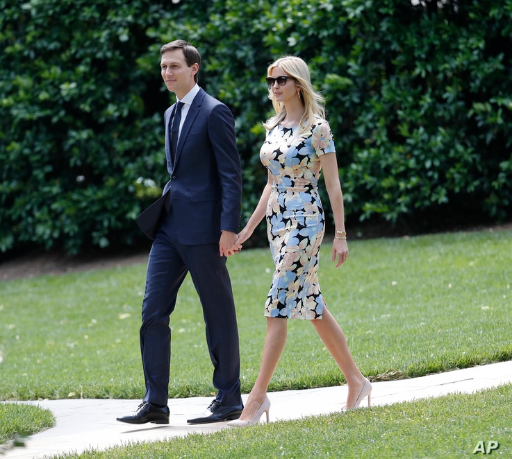Ivanka Trump, daughter and assistant to President Donald Trump, and her husband White House senior adviser Jared Kushner, walk out to join President Trump aboard Marine One helicopter, May 19, 2017.