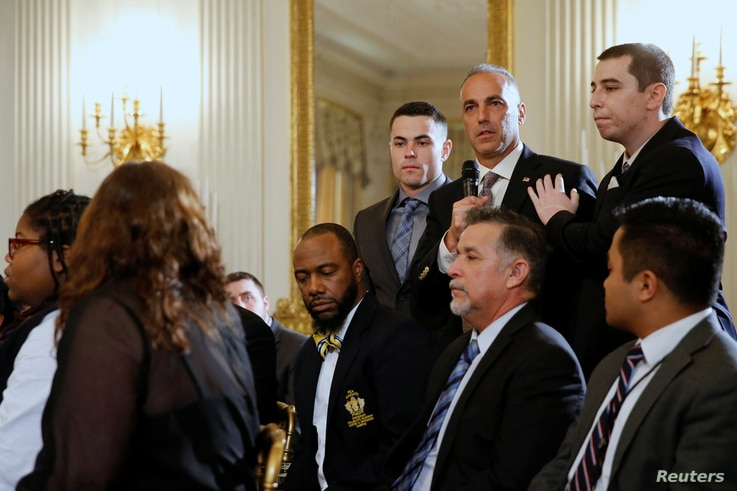Marjory Stoneman Douglas High School parent Andrew Pollack, with his sons, talks about the death of his daughter Meadow as President Donald Trump hosts a listening session with school shooting survivors and students at the White House in Washington, ...