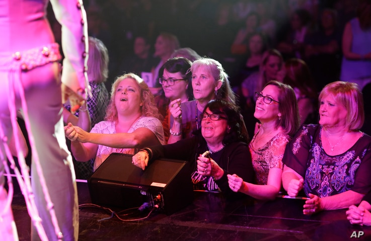 """Fans stand in front of the stage after a concert by professional Elvis tribute artists during the """"Images of the King: Las Vegas"""" festival in Las Vegas, July 15, 2017. """"In my opinion they want to see an illusion of the man and his music,"""" said festiv..."""