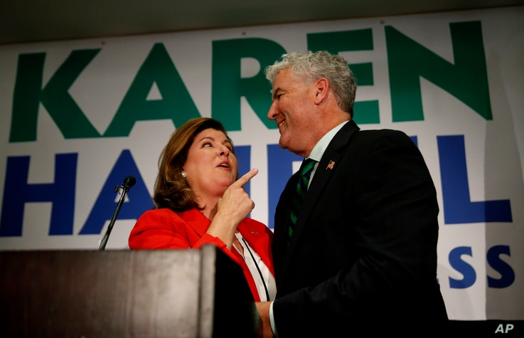 Republican candidate for Georgia's sixth district congressional seat Karen Handel stands with her husband Steve as she declares victory during an election-night watch party, June 20, 2017, in Atlanta, Georgia.