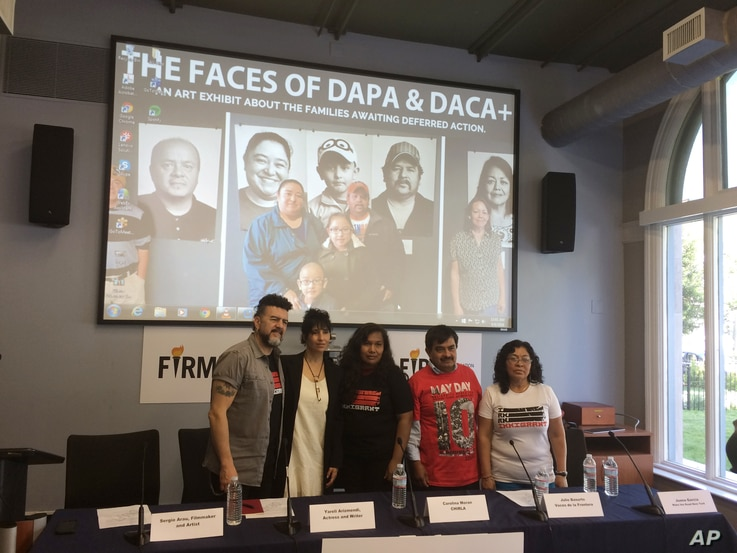 FILE - Filmmakers, from left,  Sergio Arau and Yareli Arizmendi, and immigrants Carolina Moran, Julio Basurto and Juana Garcia launch a photo exhibition in Washington June 6, 2016, about families that would be covered under an immigration executive a...