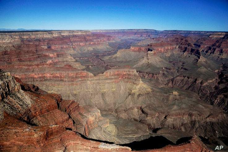 FILE - In this Oct. 5, 2013, file photo, the Grand Canyon National Park is covered in the morning sunlight as seen from a helicopter near Tusayan, Arizona, Jan. 19, 2018.