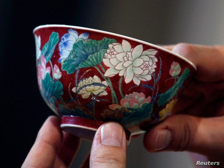 """A magnificent Ruby-Ground Falangcai """"Double-Lotus"""" Bowl Blue Enamel Yuzhi Mark and Period of Kangxi is shown after being sold for HK$74 million ($9.5 million) at Sotheby's Spring Sales in Hong Kong, April 8, 2013."""