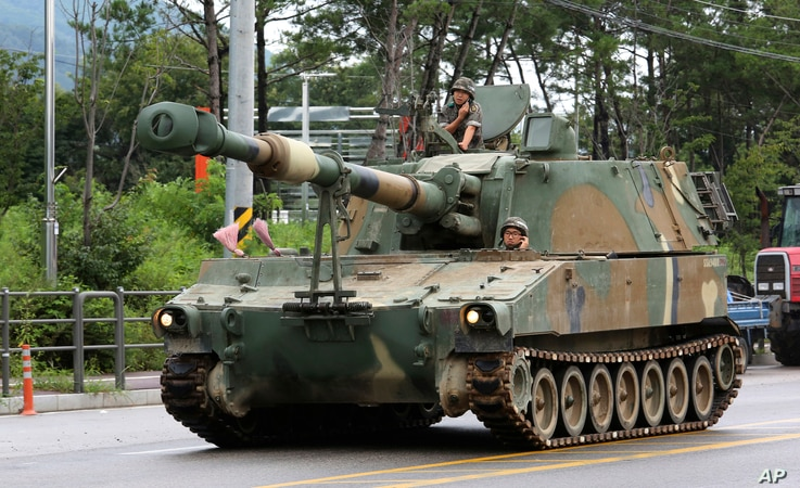 A South Korean army K-55 self-propelled artillery vehicle moves through a military exercise near the demilitarized zone between the two Koreas in Cheorwon, South Korea, Aug. 21, 2017. U.S. and South Korean troops kicked off their annual drills Monday...