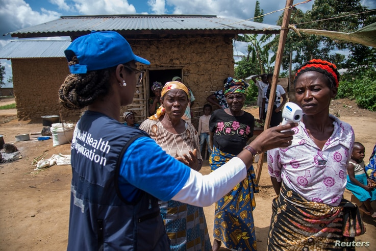 Dr.Marie-Roseline Darnycka Bélizaire, World Health Organization (WHO) Epidemiology Team Lead, talks to women as part of Ebola contact tracing, in Mangina, Democratic Republic of Congo, Aug. 26, 2018.