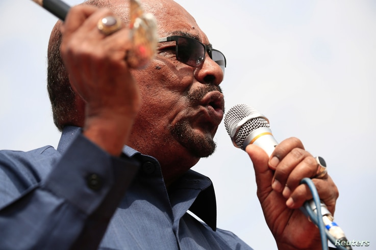 FILE - Sudan's President Omar al-Bashir addresses supporters during his visit to the war-torn Darfur region, in Bilal, Darfur, Sudan Sept.  22, 2017.