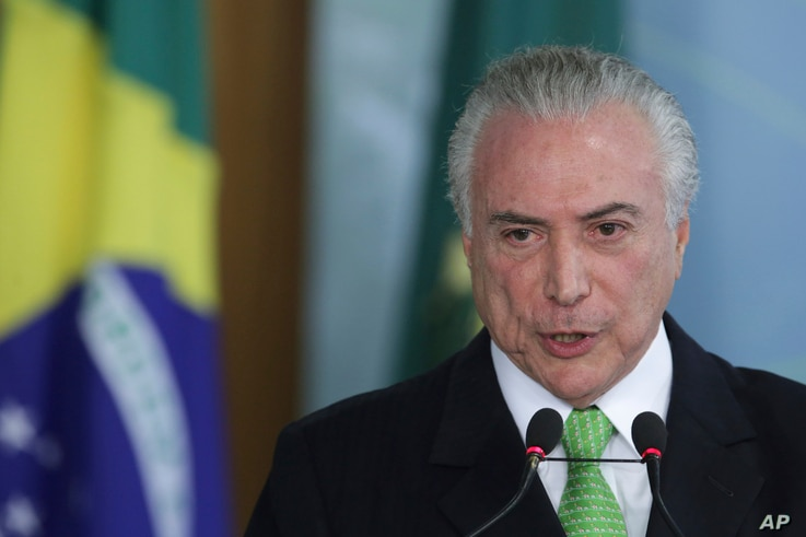 FILE - Brazil's President Michel Temer speaks during a ceremony marking World Environment Day at Planalto presidential palace in Brasilia, Brazil, June 5, 2017.