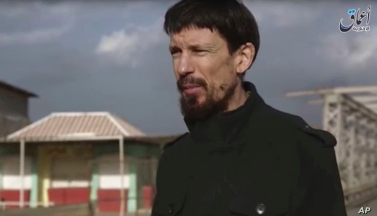 This still taken from video released  Dec 7, 2016 by the Islamic State's Amaq news agency, shows captive British photojournalist John Cantlie in what appeared to be central Mosul, Iraq.