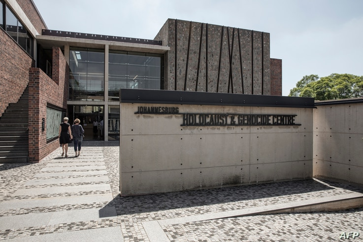 People walk toward the front entrance of the Johannesburg Holocaust & Genocide Centre for its permanent exhibition inauguration in Johannesburg, South Africa, March 14, 2019.