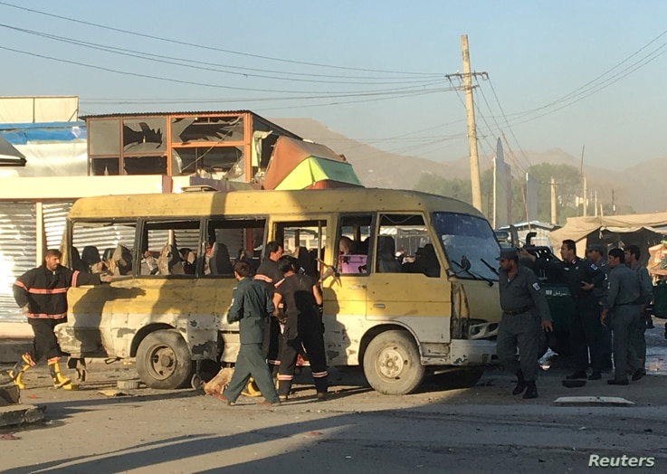 Police and fire fighters are seen at the site of a blast in Kabul, June 20, 2016.