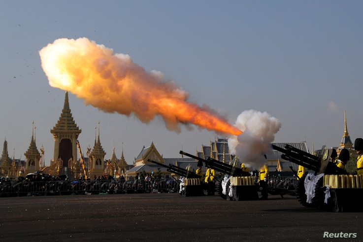 Thai royal guards salute the start of the Royal Cremation ceremony for Thailand's late King Bhumibol Adulyadej near the Grand Palace in Bangkok, Oct. 26, 2017.