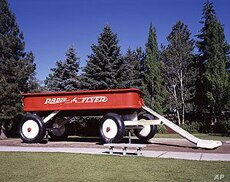 This giant Childhood Express wagon in a Spokane, Washington, park serves as a children's slide.  It was created by Ken Spiering.