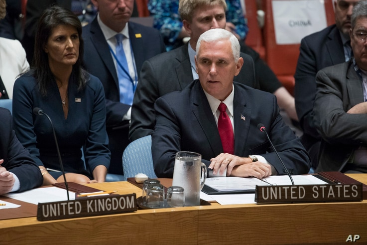 U.S. Vice President Mike Pence speaks during a high level Security Council meeting on United Nations peacekeeping operations, at U.N. headquarters, in New York, Sept. 20, 2017, as U.S. Ambassador to the U.N. Nikki Haley looks on.