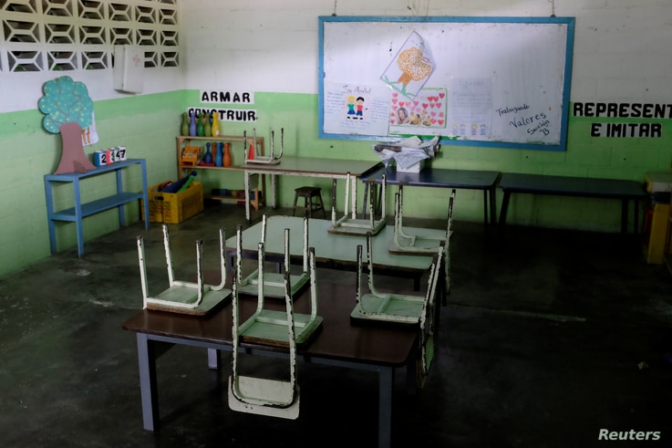 Empty desks are seen in a classroom on the first day of school, in Caucagua, Venezuela, Sept. 17, 2018.