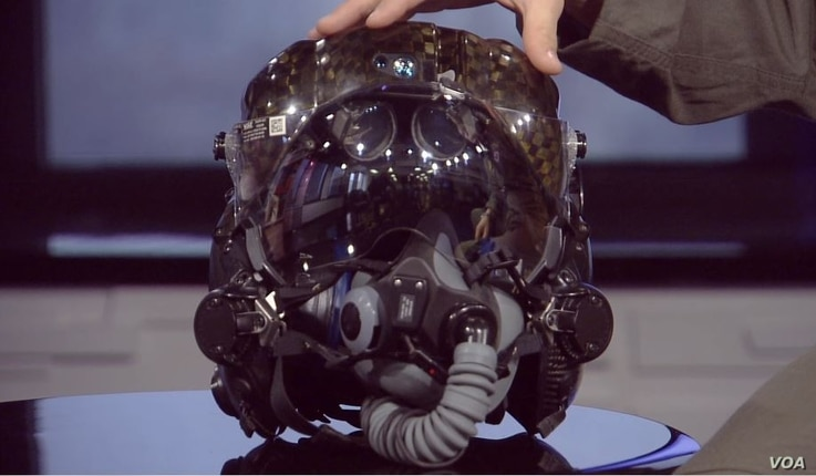 """The controversial $400,000-plus pilot's helmet is described as a """"workspace,"""" and is described as a navigation system. When the pilot is looking straight and to the sides, he sees all of the weapons employment information in the helmet visor."""