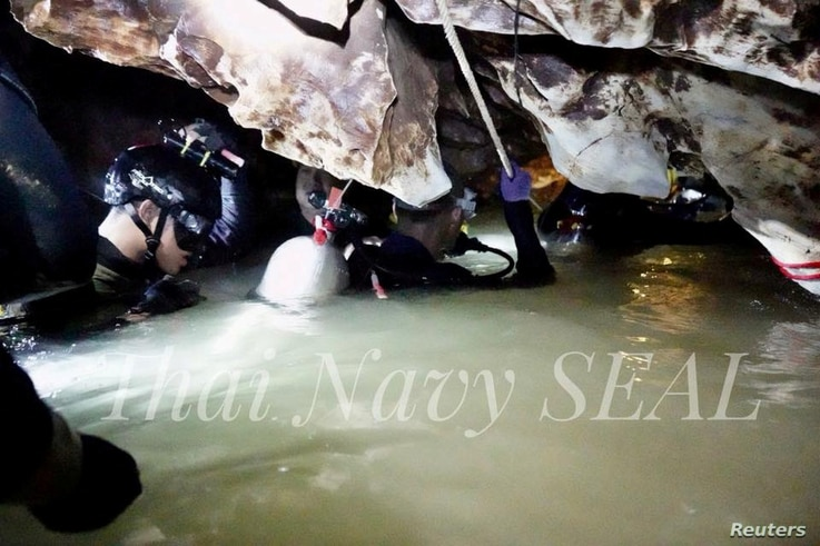 Rescue personnel work at the Tham Luang cave complex, as members of an under-16 soccer team and their coach have been found alive according to local media, in the northern province of Chiang Rai, Thailand July 4, 2018.