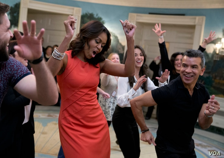 """First lady Michelle Obama dances to Gloria Estefan's """"Conga"""" in the Diplomatic Room of the White House in Washington,  Nov. 16, 2015, during a Broadway at the White House event for high school students involved in performing arts programs."""