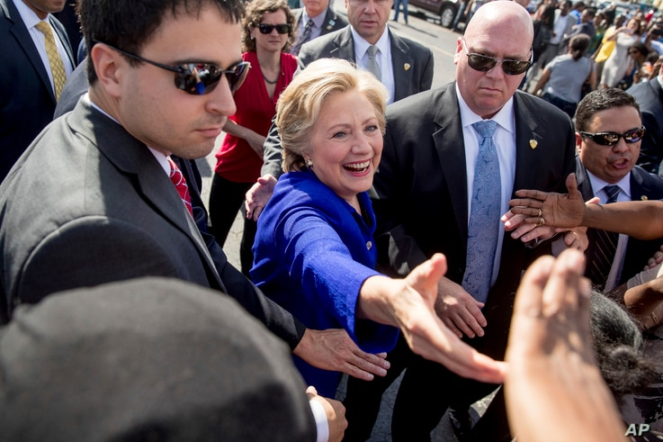 Democratic presidential candidate Hillary Clinton greets people outside an early voting center in Lauderhill, Fla., Nov. 2, 2016.