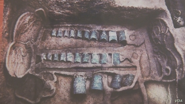 """This bianzhong (meaning """"ordered bells"""") is seen as it was excavated from the tomb of a duke of Zheng State (approximately 2,500-2,800 years ago) illustrates the extravagance of noble families."""