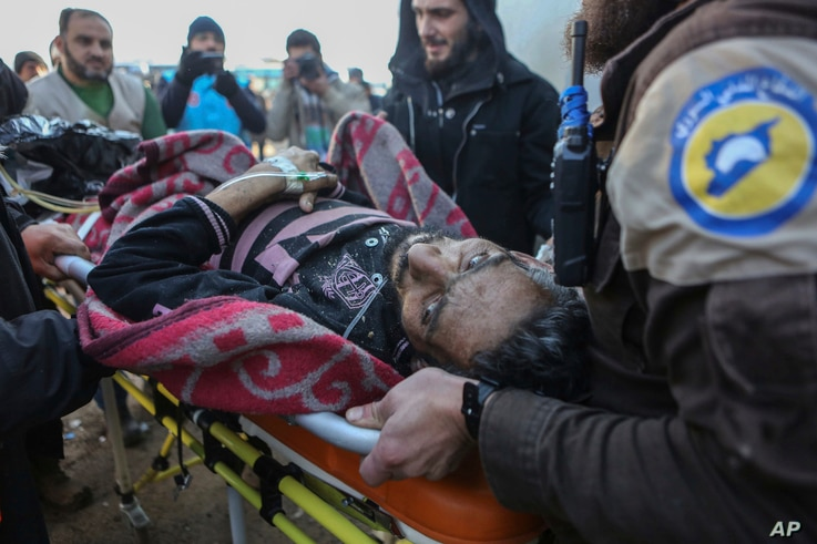 An injured Syrian arrives at a refugee camp in Rashidin, near Idlib, Syria, after he was evacuated from Aleppo during a cease-fire, Dec. 20, 2016.