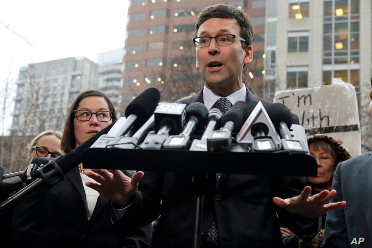 Washington Attorney General Bob Ferguson talks to reporters Friday, Feb. 3, 2017, following a hearing in federal court in Seattle. A U.S. judge on Friday temporarily blocked President Donald Trump's ban on people from seven predominantly Muslim count...