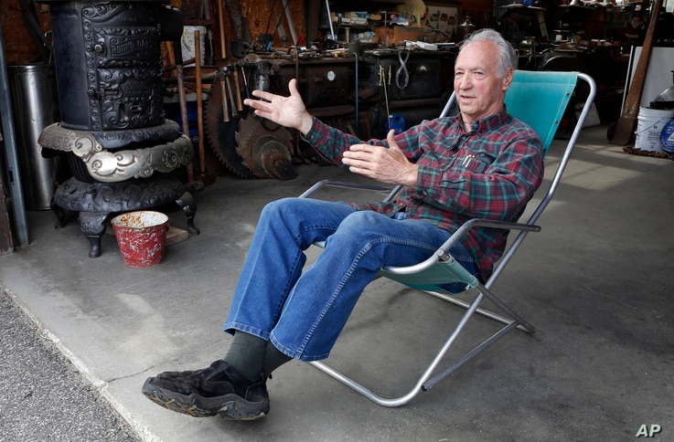 Wood stove and antique dealer Rodney Kimball speaks during an interview at his shop in West Bethel, Maine, May 14, 2016.