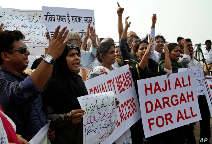 FILE - People shout slogans to support women's rights activists opposing the ban on women entering the Muslim shrine Haji Ali Dargah, in Mumbai, India, Apr. 28, 2016. A Mumbai court lifted the ban on Friday.