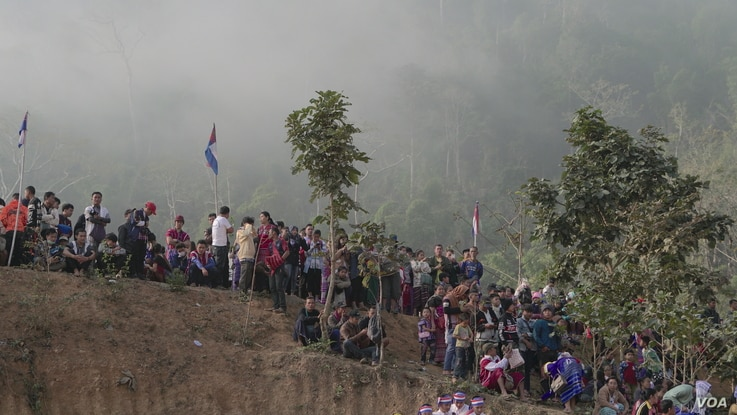 Ethnic Karen villagers and refugees watch the Karen Revolution day military parade Jan. 31, 2019, in Karen state, Myanmar, near the Thai-Myanmar border.