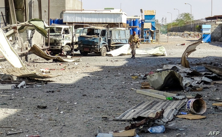 A member of the Yemeni pro-government forces walks through destruction in an industrial district in the eastern outskirts of the port city of Hodeida on Nov. 18, 2018, during the ongoing battle for control of the city from the Huthi rebels.
