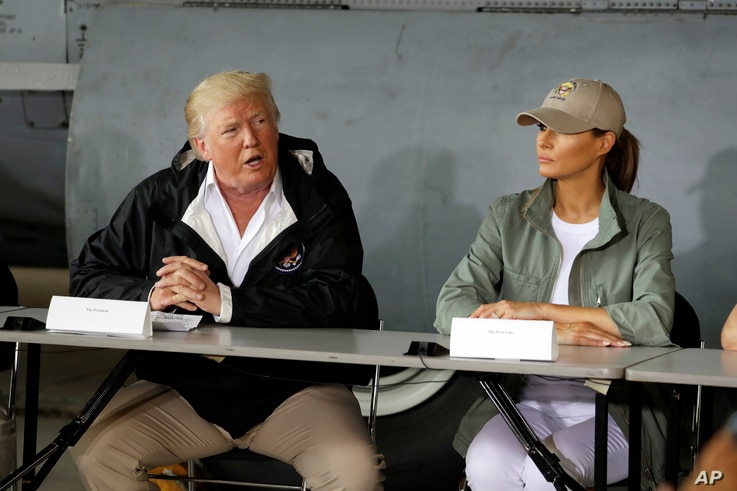 President Donald Trump talks about recovery efforts after arriving with first lady Melania Trump at Luis Muniz Air National Guard Base to survey hurricane damage, Oct. 3, 2017, in San Juan, Puerto Rico.