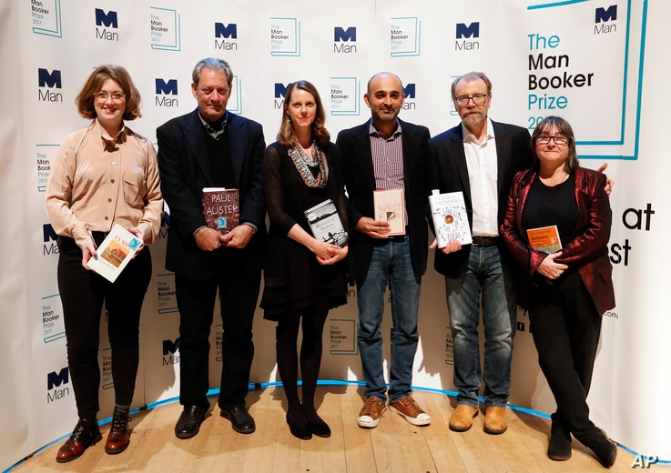 """From left, Author Fiona Mozley with her book """"Elmet,"""" Author Paul Auster with his book """"4321,"""" Author Emily Fridlund with her book """"History of Wolves,"""" Author Mohsin Hamid with his book """"Exit West,"""" Author George Saunders with his book """"Lincoln in th..."""