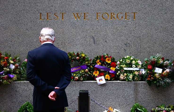 A veteran looks at floral tributes and wreaths that have been laid at the Cenotaph before the start of the annual ANZAC (Australian and New Zealand Army Corps) Day march through central Sydney, Australia, April 25, 2017.