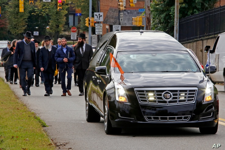 Mourners walk behind the hearse carrying the casket of Dr. Jerry Rabinowitz to Homewood Cemetery following a funeral service at the Jewish Community Center in the Squirrel Hill neighborhood of Pittsburgh, Oct. 30, 2018.