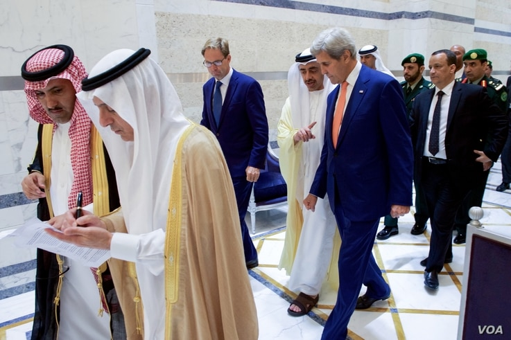 U.S. Secretary of State John Kerry walks with United Kingdom Under Secretary of Foreign Affairs Tobias Ellwood and United Arab Emirates Foreign Minister Abdullah bin Zayed on August 25, 2016, in the Royal Terminal 1 at King Abdulaziz International Ai...