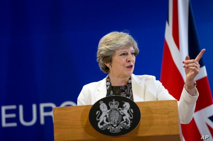FILE - British Prime Minister Theresa May Theresa May speaks during a media conference at an EU summit in Brussels on Oct. 20, 2017.