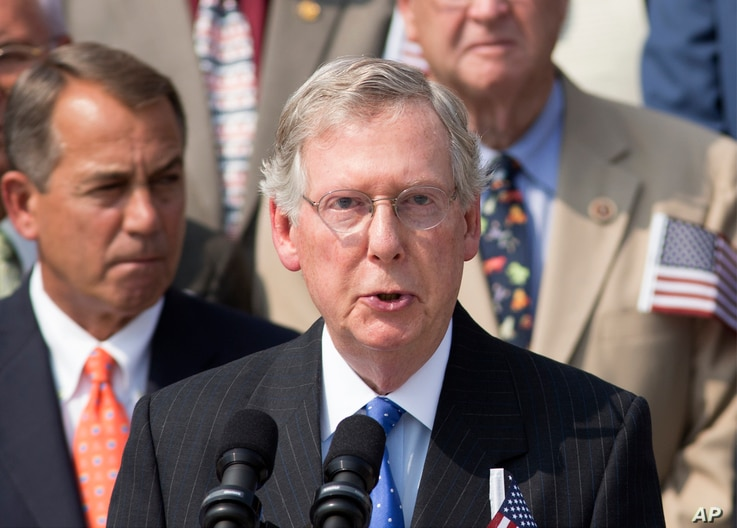 FILE - Senate Minority Leader Mitch McConnell, R-Ky., speaks as members of Congress hold a ceremony to remember the terror attacks of September 11, 2001, on the steps of the Capitol in Washington.