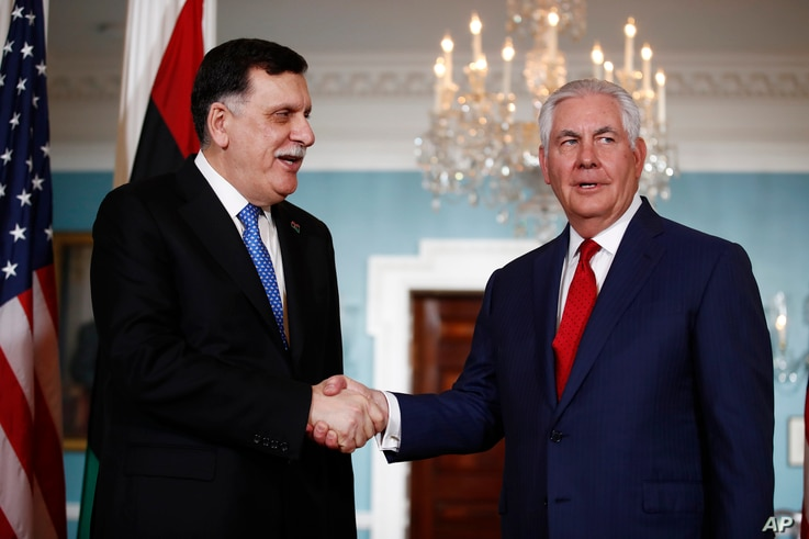 Secretary of State Rex Tillerson shakes hands with Libyan Prime Minister Fayez al-Sarraj during a media opportunity at the State Department in Washington, Dec. 1, 2017.