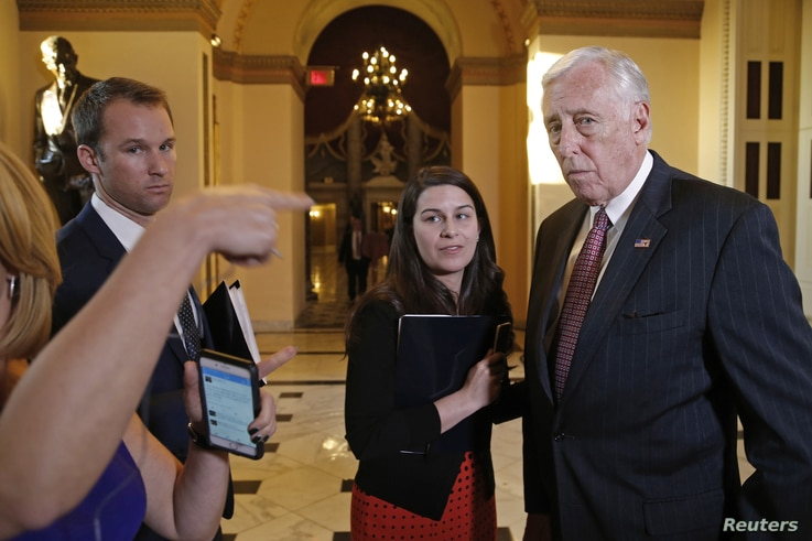 U.S. House Minority Whip Steny Hoyer, D-Md., right, talks to reporters after a failed afternoon vote on a measure to fund the Department of Homeland Security at the Capitol in Washington, Feb. 27, 2015.