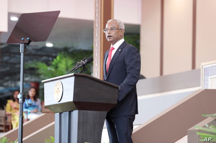 FILE- Ibrahim Mohamed Solih speaks after being sworn in as the country's president in Male, Maldives, Nov. 17, 2018. Solih is hoping a parliamentary victory Saturday will help his efforts to fulfill key pledges from last year's presidential campaign....