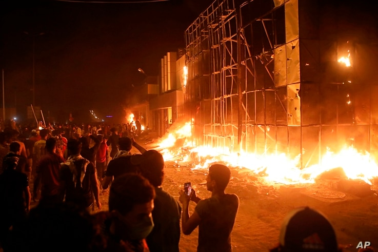 Protesters burn local parties' offices during anti-government protests in Basra, southeast of Baghdad, Iraq, Sept. 6, 2018.
