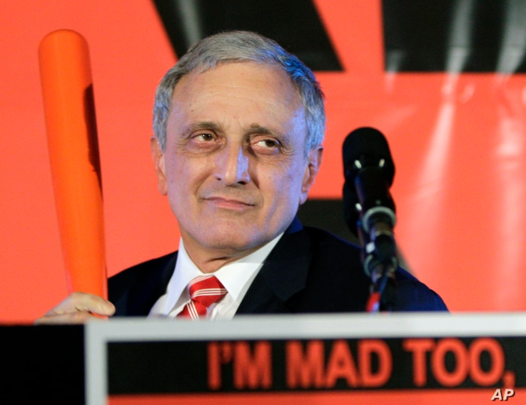Carl Paladino, an unsuccessful Republican gubernatorial candidate in 2010, holds a baseball bat as he concedes the election in Buffalo, N.Y., Nov. 2, 2010.