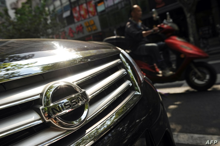 Japanese auto giants Nissan and Toyota said they would cut production in China because demand for Japanese cars has been hit by the diplomatic bitter row over disputed islands, Sept. 26, 2012..
