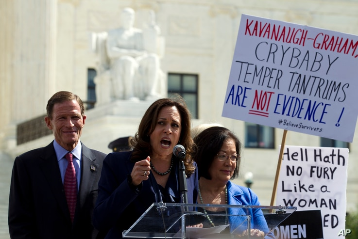 From left, Sen. Richard Blumenthal, D-Conn., Sen. Kamala Harris, D-Calif., Sen. Mazie Hirono, D-Hawaii, speak as protesters rally against Supreme Court nominee Brett Kavanaugh as the Senate Judiciary Committee debates his confirmation, Sept. 28, 2018...