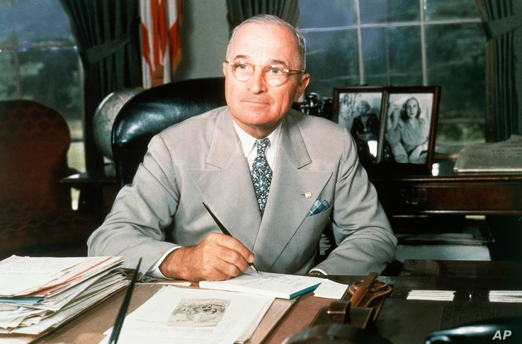 This 1948 portrait of Harry S. Truman at his White House office desk.