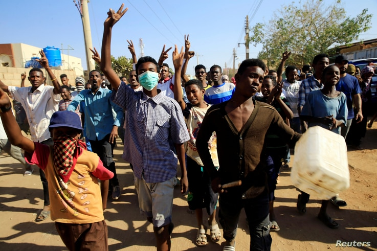 Sudanese demonstrators march during anti-government protests in Khartoum, Sudan, Jan. 24, 2019.