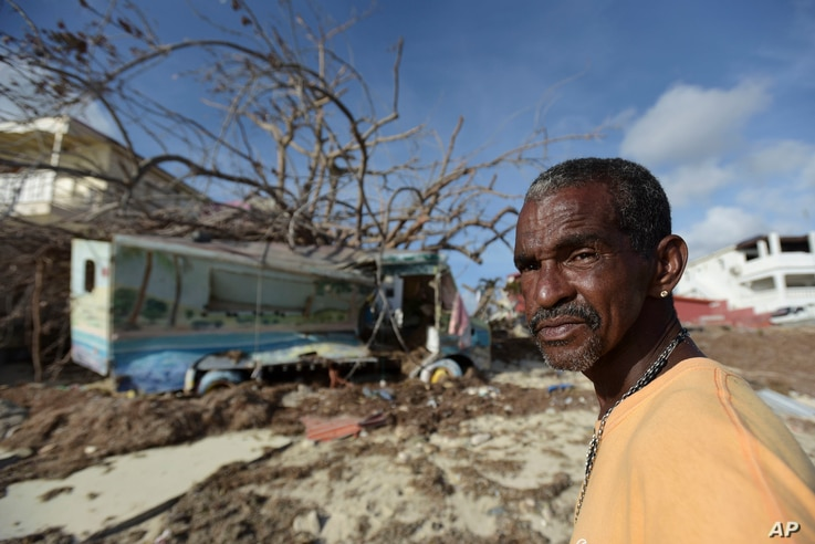 Juan Antonio Higuey shows his destroyed home at Cold Bay community after the passage of Hurricane Irma, in St. Martin, Sept. 11, 2017.