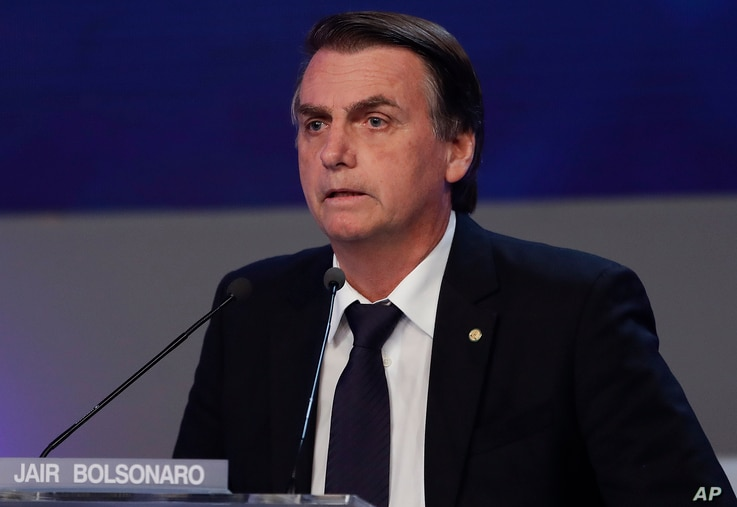 Jair Bolsonaro, who is running for president from the National Social Liberal Party, attends a presidential debate in Sao Paulo, Brazil, Aug. 9, 2018. Brazil will hold general elections on Oct. 7.