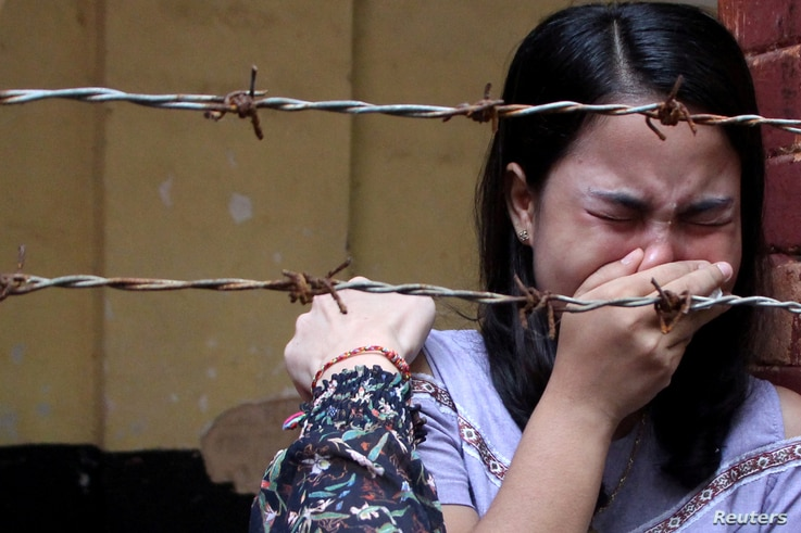 Chit Suu Win, wife of Reuters journalist Kyaw Soe Oo, reacts after listening to the the verdict at Insein court in Yangon, Myanmar September 3, 2018.